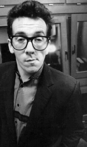 Elvis Costello as Herman Munster